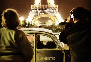 2CV driver on the banks of the Seine under the Eiffel Tower