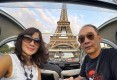 2CV couple in front of the Eiffel Tower